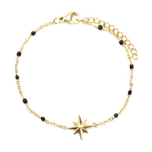 Bracelet-Fine-Chaine-Acier-Dore-et-Mini-Perles-Email-Noir-avec-Etoile-Polaire