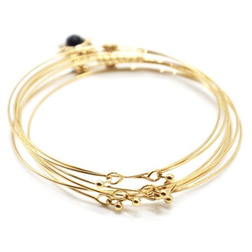 Bracelet-Semainier-Multi-Joncs-Acier-Dore-avec-Billes-Etoile-Polaire-et-Perles